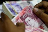 Nakon britanskih izbora funta ojačala, dolar oslabio